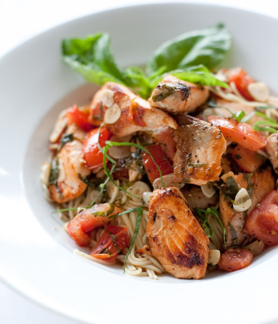 Salmon Angel Pasta sautéed in a Garlic, Basil, Light Tomato Sauce