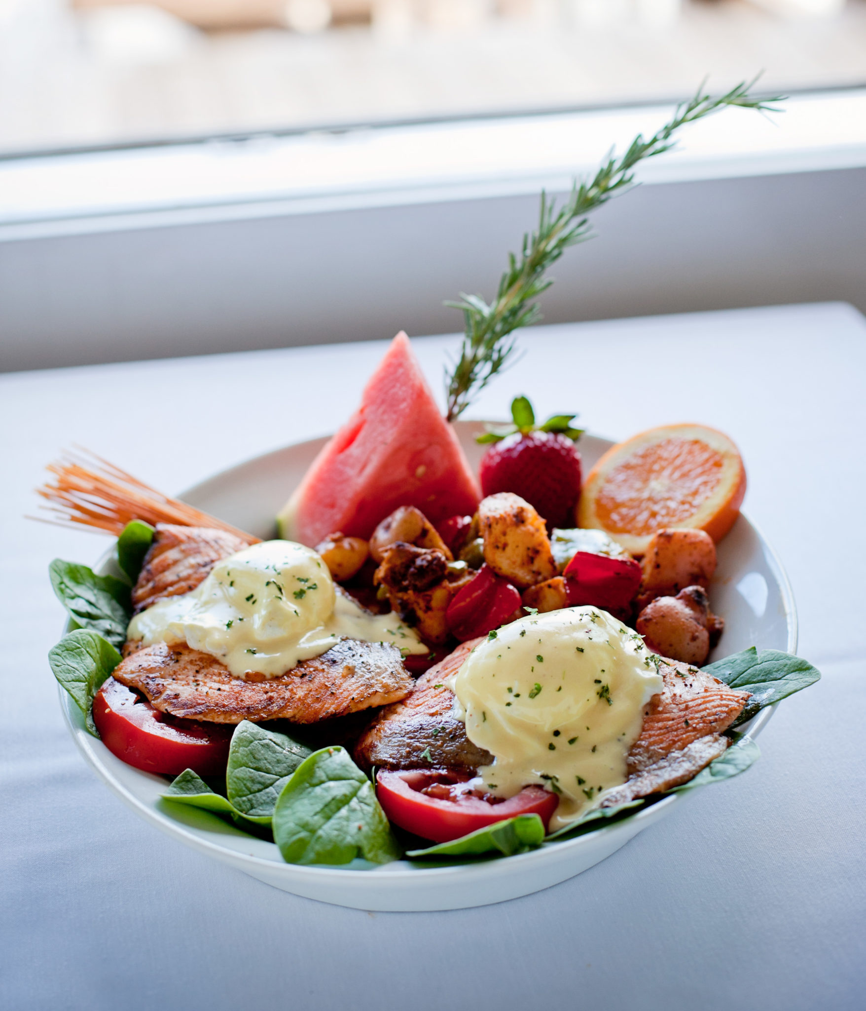 Salmon Benedict  - with spinach , tomatoes, two poached eggs and Holandaise Sauce